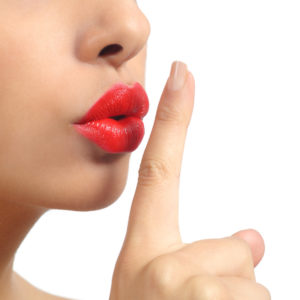 Close up of a woman lips with finger asking for silence-confetti-design